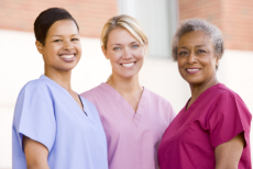 three smiling female caregivers